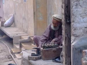 Man selling bottles in Peshawar