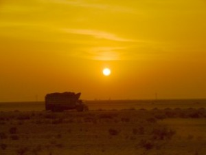 A lone truck at sunset from the train to Peshawar, Pakistan