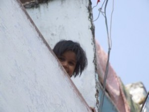 Small girl playing hide and seek in India