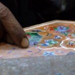 Jewellers in Agra, India - Delicate slivers of gems being paced into marble in Agra