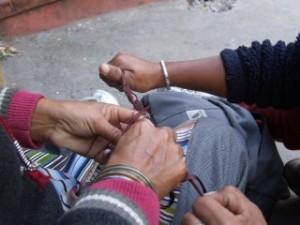 Tibetan Ladies in Nepal repairing my wrist band