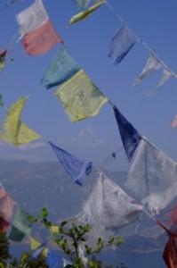 The Annapurna Mountain range and Lake Phewal Tal through Prayer flags, Nepal