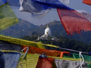 A view of the World Peace Stupa through prayer flags, Pokhra, Nepal (click to enlarge)