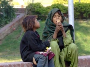 Street children eating ice cream in Lahore