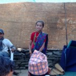 Girl singing at rural Nepalese wedding