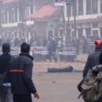 Police throwing bricks back
