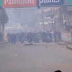 The riot police charge forward in Kathmandu