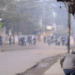 Running from the riot police charge (click to enlarge)