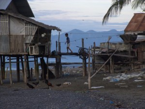 Stilt house and boy at dawn in Brooke's Point, Palawan, The Philippines (click to enlarge)
