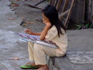 Lone Filipina Girl Playing a Xylophone