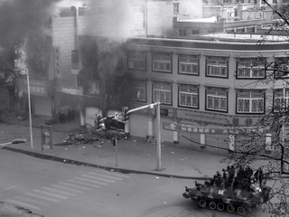 An armored personal carrier cornering some locals during the 2008 riots in Lhasa