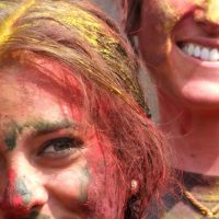 Tourists covered in color in Nepal for Holi