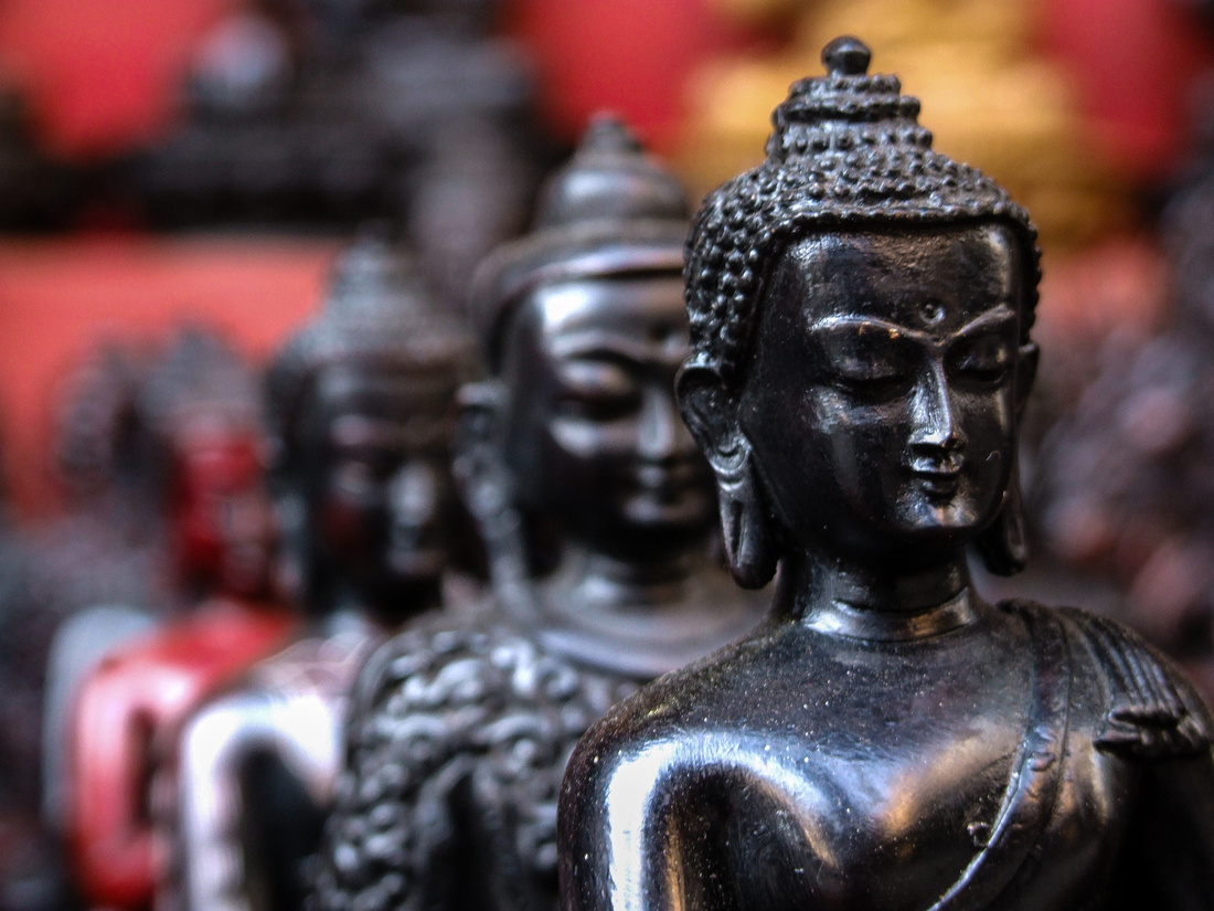 wooden Buddha statues in Nepal