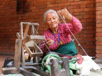 Woman spinning yarn in Nepal