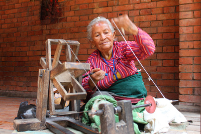 Woman spinning yarn in Nepal