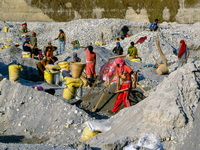 Families working in a river mine in Nepal