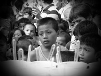 Filippino boy waiting for food aid in The Philippines