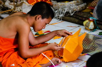Monk sticks decorations on a paper lantern