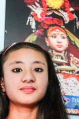 ari Samita Bajracharya,with a photograph of her when she was a goddess, Nepal