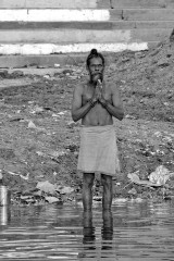 Man in Morning Prayers on the Ganges - India