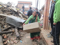 Old Woman collecting Aid after the Earthquake in Nepal recovery