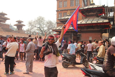Man waving Nepalese flag