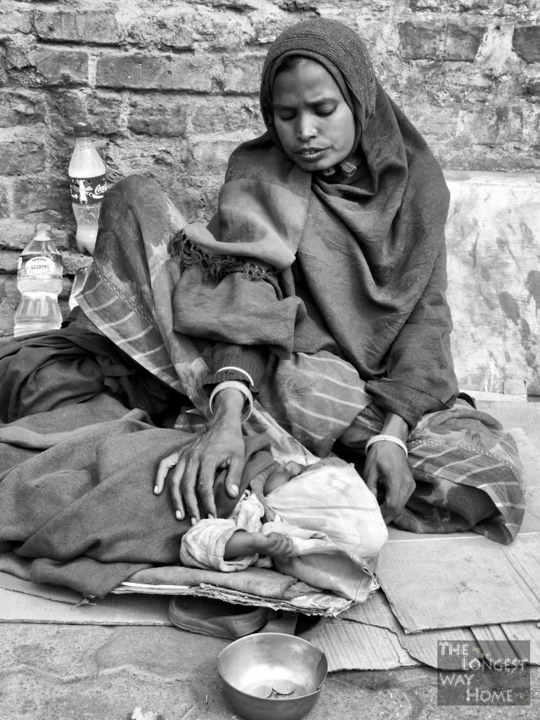 Homeless mother and baby in nepal resize 768x1024