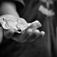 Child holding Money in Nepal_resize