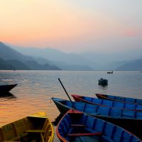 Boats by Phewa Lake in Pokhara , Nepal