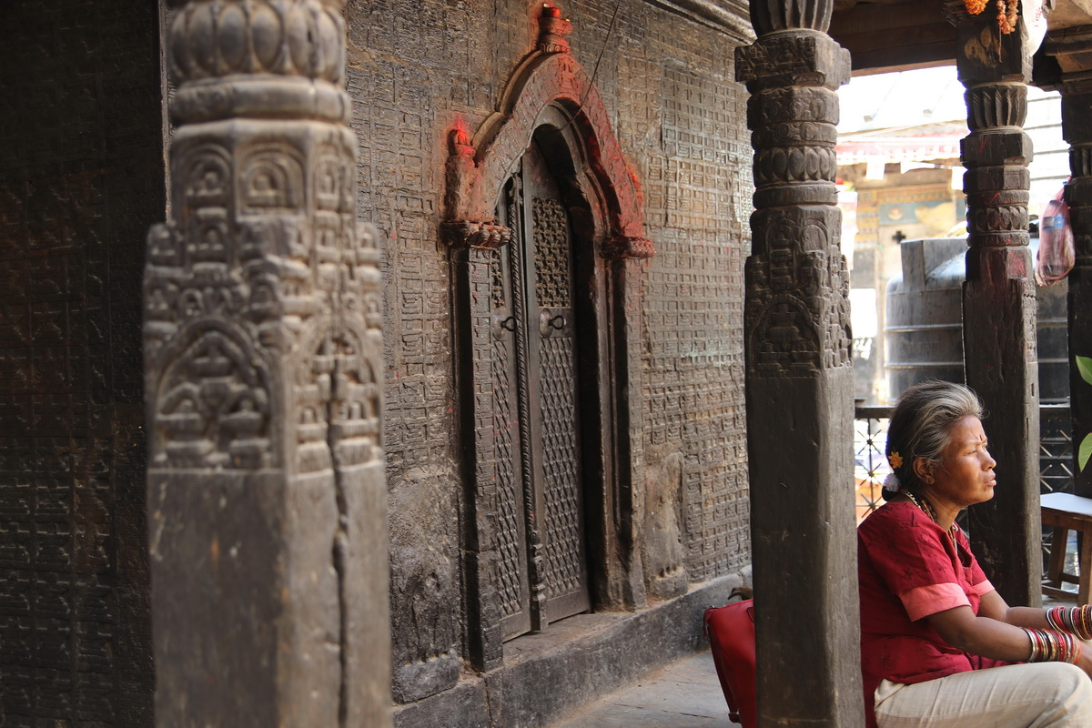 Woman sitting on Koti Mahadev Temple