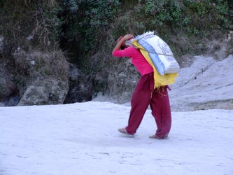 Nepalese girl carrying sand