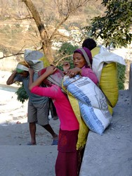 Nepalese Mother and Daughter carrying sand