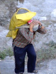 Nepalses man carrying a sack of sand