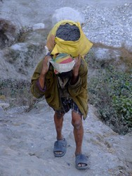 Nepalese man carrying grave from a mine