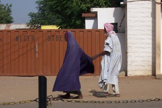 Old couple walking in Kano